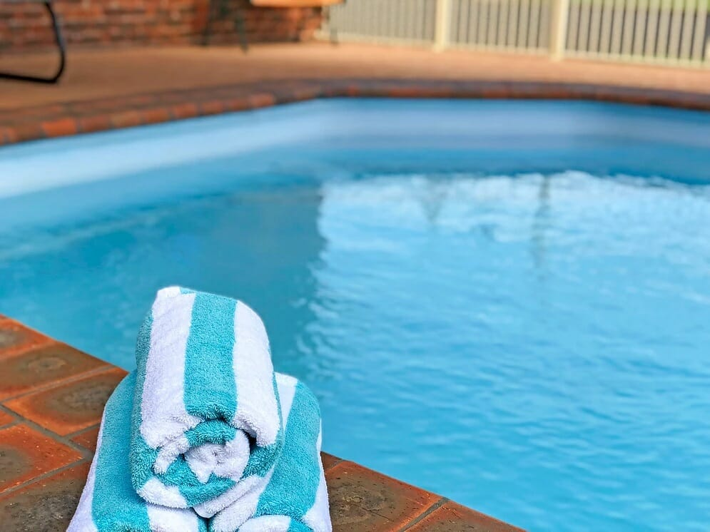 Pool with rolled towels at the Leeton Heritage Motor Inn